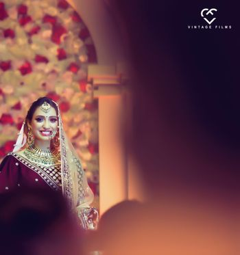 Smiling bride shot in maroon lehenga