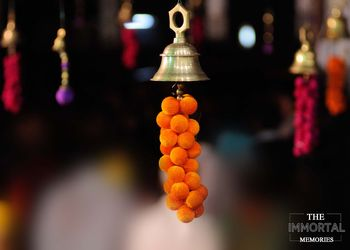 Hanging decor with temple bells and fabric balls
