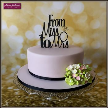 Photo of Bachelorette party cake with topper