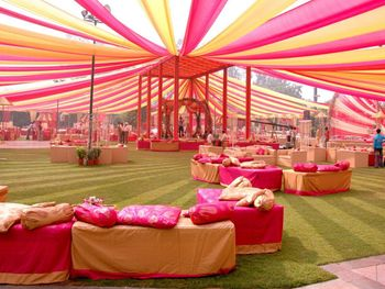 Ceiling decor done with colourful drapes for an outdoor ceremony.
