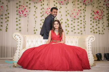 Full flared red engagement gown