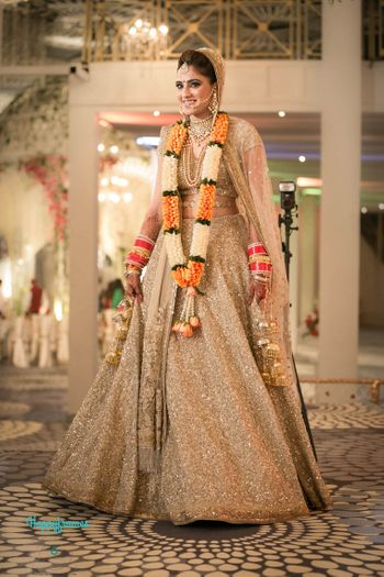 Stunning bride in gold lehenga