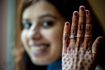 Engagement ring photography with mehendi hands