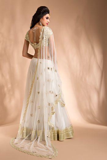 Photo of white and gold lehenga