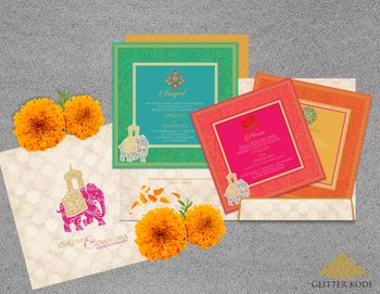 Photo of Bright Indian wedding cards with elephant motif
