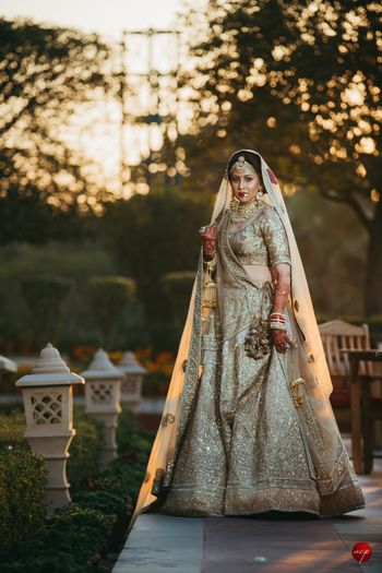 Photo of Shimmery gold bridal lehenga monotone
