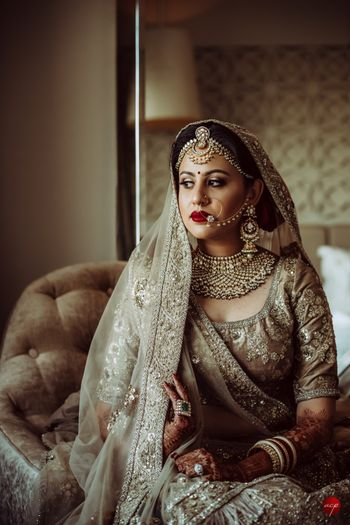 Photo of Bride in offbeat grey bridal lehengas