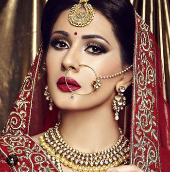 Red and gold bridal makeup with smokey eye