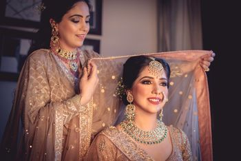 Pretty bride with her sister