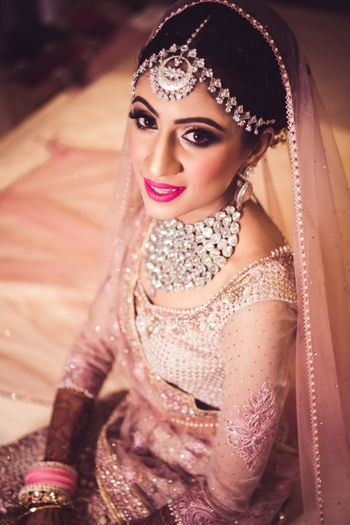 Pretty bride wearing silver jewellery