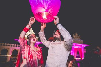 Bride and groom releasing sky lantern