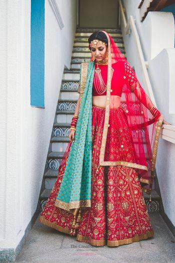 Red gota patti lehenga with turquoise dupatta