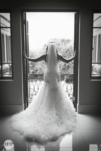 Photo of Black and white portrait with ruffled gown with train