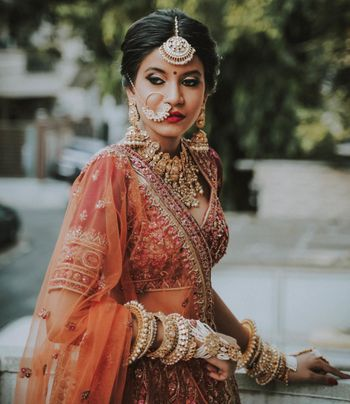 over the top bridal jewellery with necklace nath and haathphool