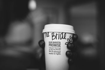 Photo of Bride holding coffee cup with name