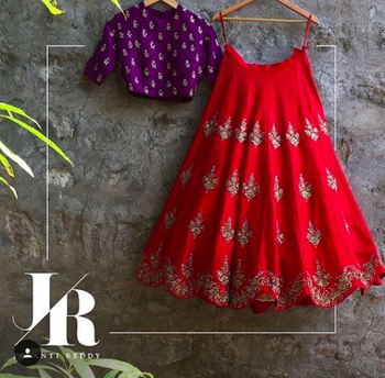 Photo of Scalloped edge lehenga in red with contrasting purple blouse