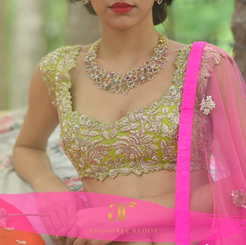 Photo of Mehendi lehenga in light green and pink