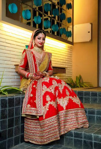 Bengali bride wearing sabyasachi lehenga