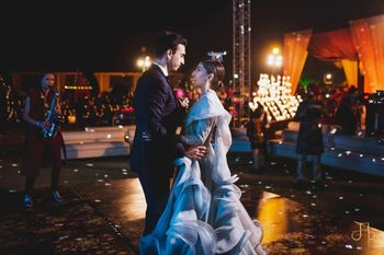 Photo of romantic couple dance shot idea with frilly lehenga