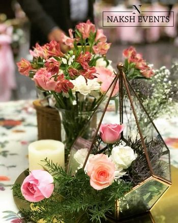 Terrariums filled with flowers used as a centrepiece.
