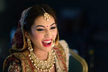 Happy bride wearing bright red lipstick