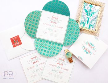 Photo of Turquoise and white wedding cards