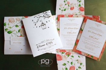 Pastel floral wedding cards with bird cage design