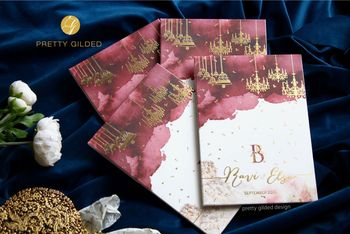 Photo of maroon and gold modern wedding invites
