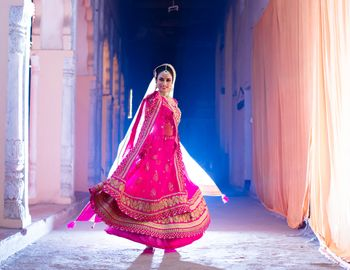Twirling Pink Bridal Lehenga Shot