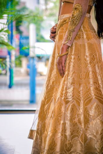 Photo of Gold lehenga with zari work and embroidery