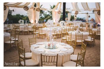 Round table setting  with gold and cream theme