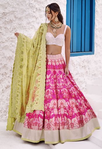 pink lehenga with white blouse and pretty net dupatta