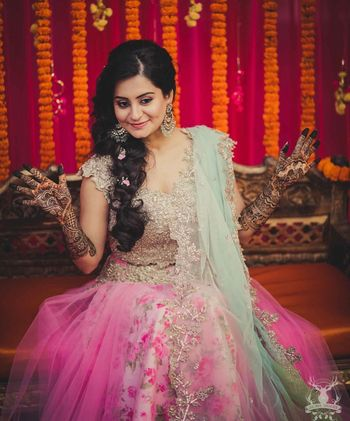 Bridal mehendi look with Anushree reddy lehenga and side braid