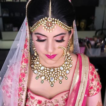 Graceful pink bridal makeup