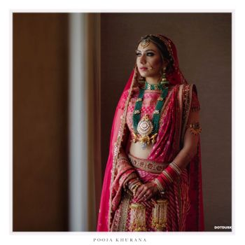 Red lehenga with green jewellery with beads