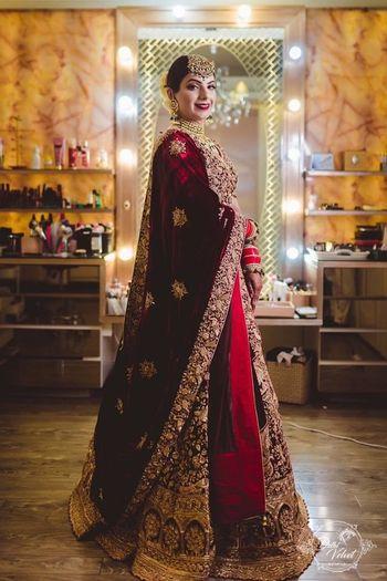 Photo of An over the top, stunning velvet bridal lehenga