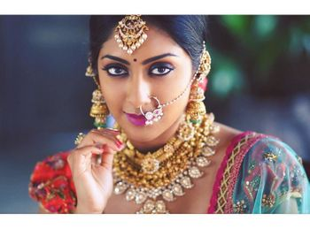 Photo of Mismatched bridal jewellery with gold and stones