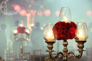 Silver Lantern Candelabras ans Roses as Table Decor
