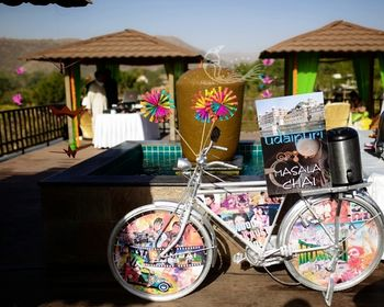 Udaipuri chai stall on decorated bicycle with pinwheels