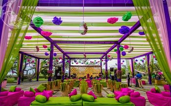 Colourful mehendi decor with hanging paper lamps