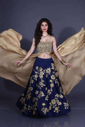 Navy blue lehenga with floral embroidery and gold blouse