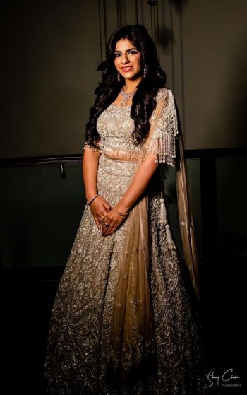 Photo of Bride wearing a fully embellished olive green lehenga