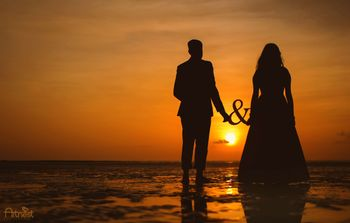 Pre wedding shoot sunset shot on the beach with prop