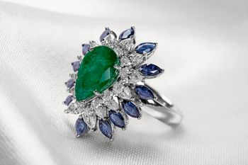 emerald and sapphire cocktail ring with diamonds
