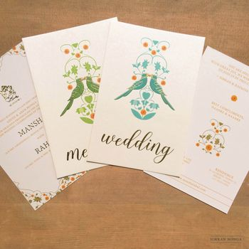 Simple white wedding card with bird motifs