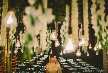 Photo of hanging floral strings and bulbs decor