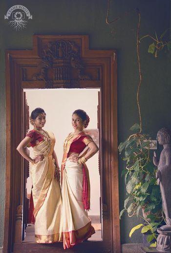 south indian bridesmaids wearing color-cordinated kanjivaram saree