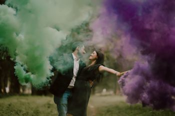 pre wedding shoot with couple holding smoke sticks