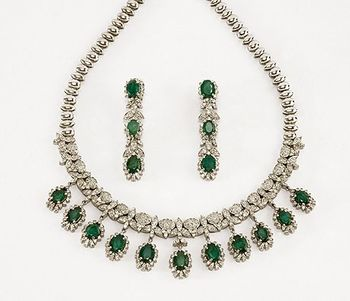 Photo of diamond and embellished green necklace and earrings