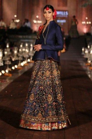 Photo of navy blue lehenga skirt and silk jacket